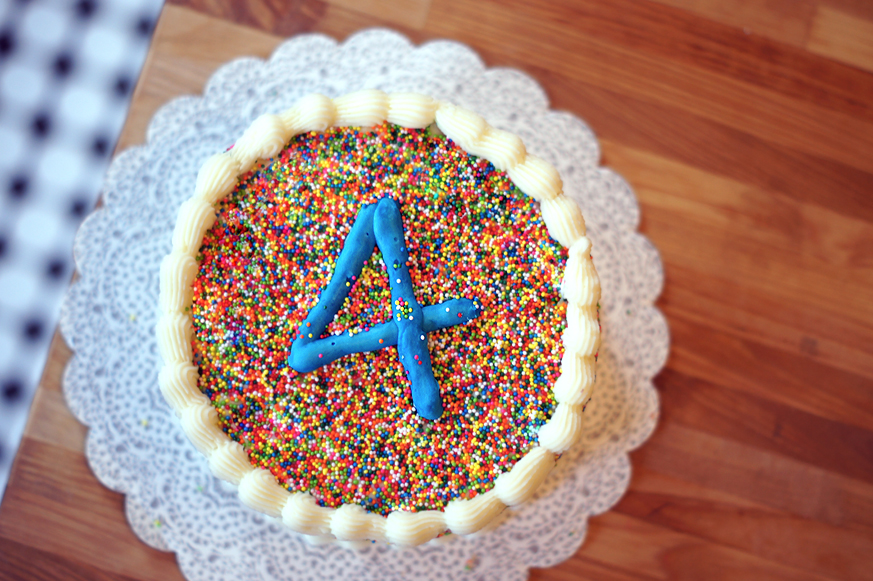 Sprinkle Covered Birthday Cake with homemade Funfetti cake inside! (Plus the secret to covering a cake in sprinkles without rolling the whole cake around!)